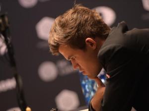 Carlsen imposes his genius on Caruana